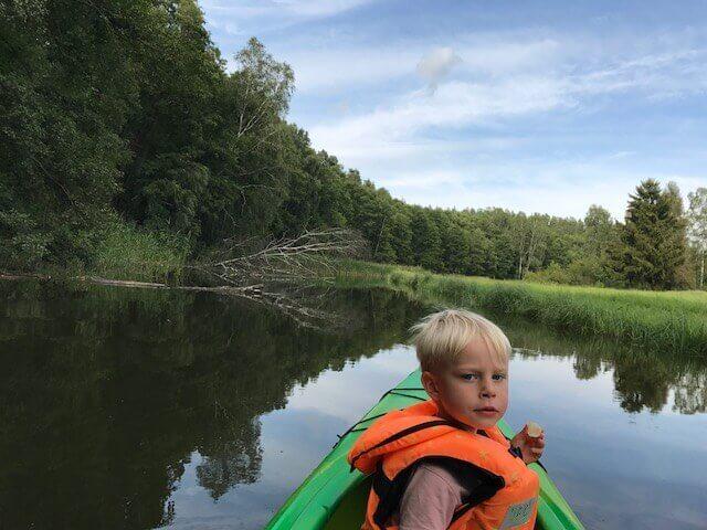 A child on a kayak trip